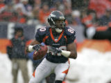 In the second quarter,  Denver Bronco wide reciever Rod Smith drops back to lateral the ball to...