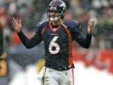 In the second quarter, Denver Broncos quarter back Jay Cutler reacts to a 36 yard complete pass to...