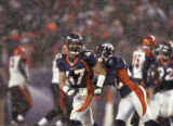 In the Fourth quarter, Denver Broncos players John Lynch, left, and Domonique Foxworth, right,...