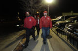 From left, Gary Borum, Johnny Johnson, Susan Allen and Mike Olson,  patrol the streets around the...