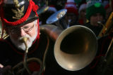 Mike Park (cq), plays his Around the Shoulder Euphonium during the 32nd annual TubaChristmas...
