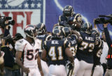 BG0823 In the fourth quarter, San Diego Chargers LaDainian Tomlinson, right,  is hoisted in the...