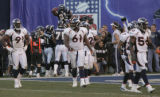BG0993 In the fourth quarter, San Diego Chargers LaDainian Tomlinson, right,  is hoisted in the...