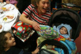 MJM315 Trish Vigil (cq), top center, shows her excitement for Christmas gifts for her daughter,...