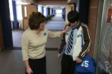Principal Algiene asks basketball player Gideon Lucero, 16, Junior, (cq), about his undone tie. He...