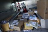 Mail carrier Doug Fischer (cq) looks through the Express Mail packages that he still has to...