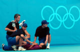 (ATHENS, GREECE - AUGUST 15, 2004)   Tennis officials tend to the needs a ballboy who fainted from...