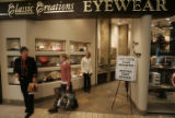 Shoppers brows Classic Creations Eyewear Tuesday afternoon Dec. 26, 2006 at Cherry Creek Shopping...