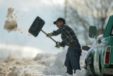 Joe Lucero (cq) of Denver shovels snow from in front of his son's home on Tennyson Street near W....