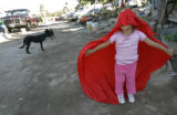 BG1660 Border Street: Vanessa, CQ, 3, the Legal Permanent Resident's niece, twirls around in a...