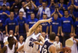 Air Force Academy center John Frye guards BYU guard Austin Ainge, right, in the second half of...