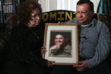 JM1029 -  Larry and Davida Gonzales pose for a portrait of their 18-year-old grandson Dominic Paul...