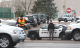 Jefferson County Sheriff Deputies divert traffic away from the front of  Columbine High School...