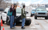 Columbine High School students (no ID's possible) cross Pierce Street to retrieve their cars  from...