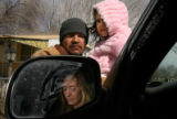MJM369 Deanna Ramirez, seen in her vehicle's side view mirror, is pictured with husband, Julio...