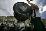 Tom Farrell with the Michael Collins Pipe and Drum plays the bass drum after the McClain Finlon...