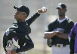 Colorado Rockies pitcher Denny Bautista throws during during Spring Training at the Hi Corbett...