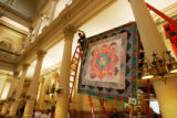One of over 200 handmade quilts is installed in the Capitol on March 2, 2007.  This one was made...