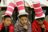 First graders from North Elementary School in Brighton listen to Terri Romano (cq), a member of...