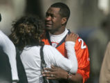 Family members pour out of a viewing for Denver Bronco and former University of Missouri-Columbia...