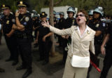 (8/30/04, New York, NY)  Carol Chase, New York, yells at a demonstration across the street from...