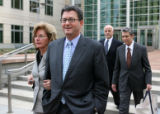 Former Qwest CEO Joe Nacchio, center, and his wife Anne (Reported through Bloomberg News) leave...