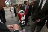 DLM1749  People stand in line to plug change into a new Donation Meter, which is part of a new...