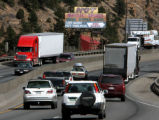 Traffic moves through Idaho Springs on I-70 past the Hot Mineral Springs sign, Wednesday...