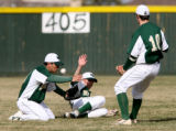 Machebeuf players Adam Gomez, Ryan Owen, and Mike Hensen all go for a fly ball in the top of the...