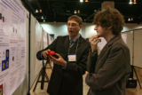 Stephen M. Anthony (cq), left, University of Illinois, presents research on Microscale Curveballs...