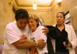 "(from left) After exiting the courtroom, ""DJ"" (cq)  comforts his aunt, Helen Rodriguez..."