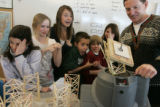 Fifth-graders at Denver's Graland Country Day School gather around science teacher Andy Dodge in...