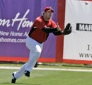 FLGP112 - Cincinnati Reds left fielder Adam Dunn makes the catch of a fifth inning fly ball by...