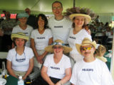 Polo Cops team supporters at the Chicks With Sticks benefit include, seated from left, Debbie...