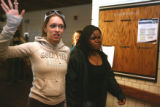 L to R: Cree Corley (cq) and Tomeka Hayworth (cq) walk past the media after a hearing at the...