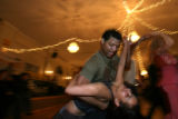 DLM1892  A.J. Washington, 27, dips Marcela Lay, 33, as the two dance together before the start of...