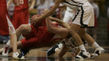 Glenwood's #44  Sam Ciani tries to hold onto the ball as Harrison's #25 Alystia Moore takes her...