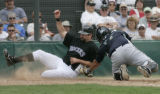 AZEA103 - Colorado Rockies' Todd Helton, left, slides into home to score as Seattle Mariners...