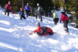 A Wilderness Trekking School student practices self-arrest on the snow travel field day. NOTE:...