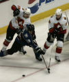 Flames Mathew Lombardi (l) and Marcus Nilson try to get the puck from Avs. Mark Rycroft at the Avs...