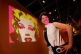 Laura West with a Warhol-ized projection of Marilyn Monroe. (STEVE PETERSON/SPECIAL TO THE...