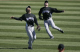 Colorado Rockies Kazuo Matsui, left, and outfielder Brad Hawpe, right,  have a slight...
