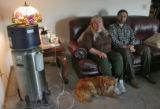 Laura Schultz, (cq), left, with her husband Jeff Schultz (cq), and their dog Sophie, at their...