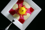 Food at L'Atelier in Boulder for the Dining Guide.  Saffron poached pear with rasberry coulis,...