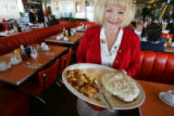 Waitress Roxanne Stacey delivers a Texas steak to a customer at the Breakfast King on March 1,...