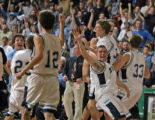 Ralston Valley Mustangs Zach Johnson, right, leads his team in rushing the floor after the...