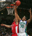 East High School's Jordan Martinez-Doublin, left, fights for a rebound against Doherty's VJ...