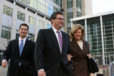 Former Qwest CEO Joe Nacchio, center, leaves federal court with his son and wife Anne after the...