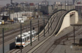 A view from the Evans Ave., bridge, where Light rail trainst run on tracks right next to the...