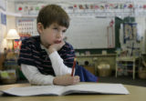 Sam Koskinen (cq), 5, takes a moment to think about what he wants to write in his journal in his...